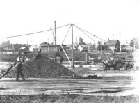 Unloading coal along canal in 1901
